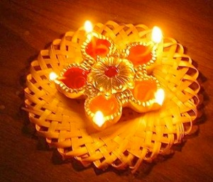 Warm orange glow of the diyas