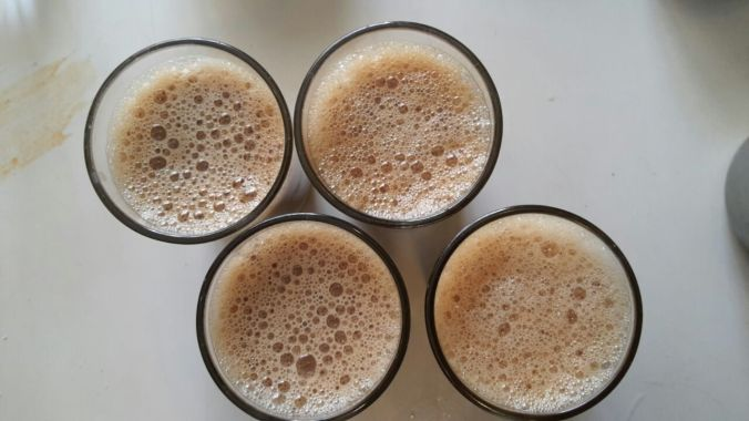 Fresh coffee in short glasses , not cups