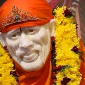 Sai Baba in saffron orange robes