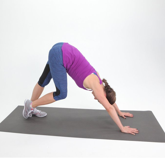Down Dog Calf Stretch. Image source : POPSUGAR Studios