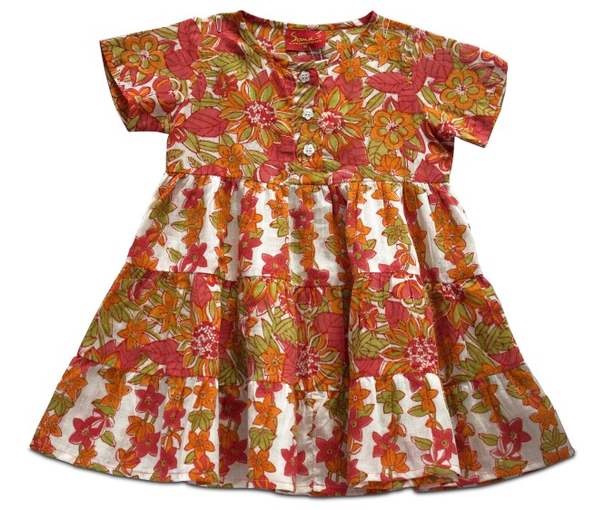 With splashes of red, orange and green on a white cotton hand block printed frock