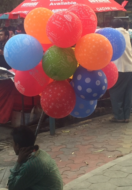 Boy selling balloons