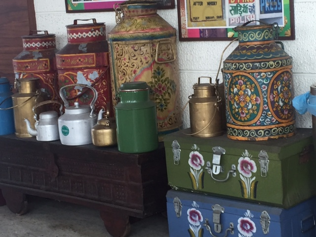 metal trunks, cannisters, kettles and antique wooden box at Chennai Express restaurant in the city airport