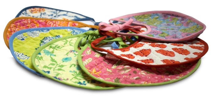 Assorted colourful bibs in cotton and hand-block printed