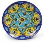 ceramic pottery with indigo, blue, yellow and green floral designs, the sandalwood room