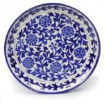 blue pottery wall plate with floral patterns, the sandalwood room