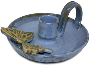 blue ceramic candle holder with butterfly decoration, the sandalwood room