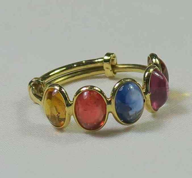 multi coloured sapphire adjustable ring in 18 carat gold at The sandalwood room