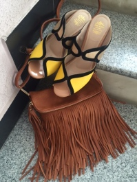 yellow wedge sandals and brown fringe sling bag