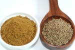 Closeup view of cumin and cumin powder