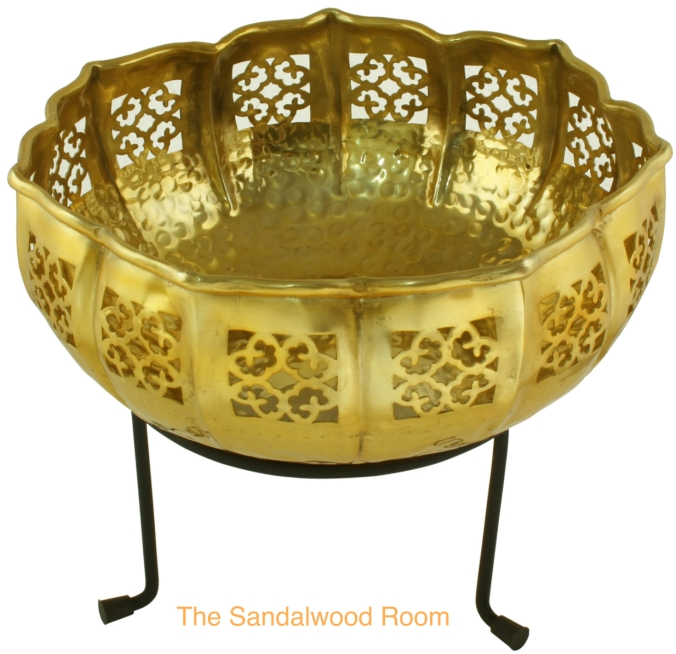 decorative filigree metal bowl mounted on a stand, the sandalwood room