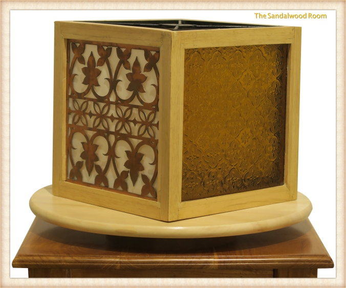 Decorative lamp with glass and laser cut copper filigree inlay, the sandalwood room